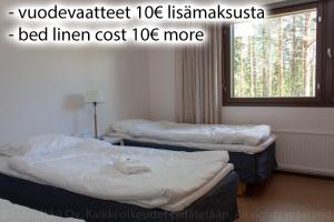 A bed or beds in a room at Hömäkkä Oy