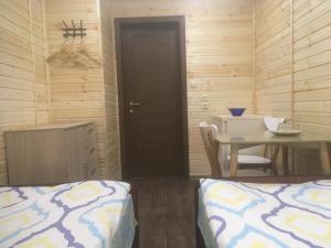 Кровать или кровати в номере Аврора