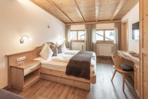 Letto o letti in una camera di Villa David Dolomites