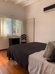 A bed or beds in a room at Dream Cabanas