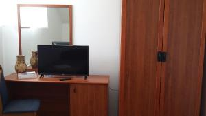 A television and/or entertainment center at Hotel Terex