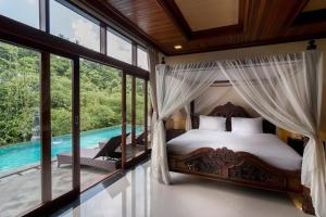 A bed or beds in a room at The Payogan Villa Resort and Spa