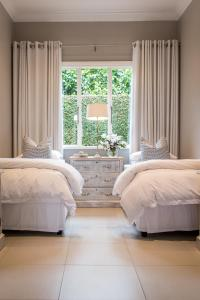 A bed or beds in a room at Lexden
