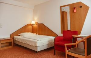 Ein Bett oder Betten in einem Zimmer der Unterkunft Aviva Apartment Hotel