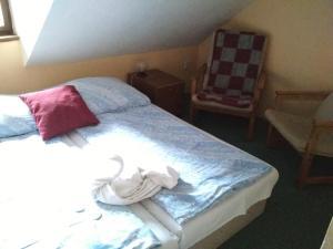 Кровать или кровати в номере Penzion U Tkadlen