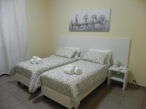 Letto o letti in una camera di Hotel Villa Romana