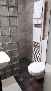 Ванная комната в Hotel Le Grand Colombier