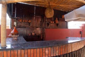 A kitchen or kitchenette at Apparts-hôtel ISNI