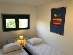 A bed or beds in a room at Apple Tree Guest House