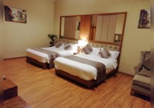 Cama ou camas em um quarto em منازل جدة للوحدات السكنية