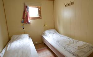 A bed or beds in a room at Gjøvik Hovdetun Hostel