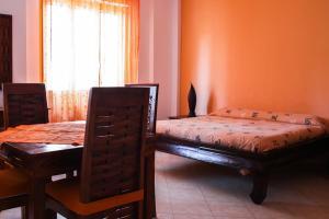 Letto o letti in una camera di Marisal Accomodation