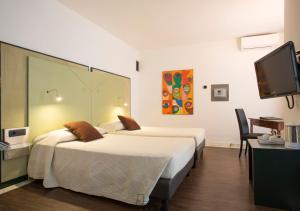 Letto o letti in una camera di Hotel Buonconsiglio