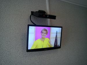 A television and/or entertainment centre at Grante Motel