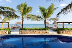 The swimming pool at or near Mereva Tulum by Blue Sky