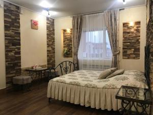 Кровать или кровати в номере Мини-отель Энигма
