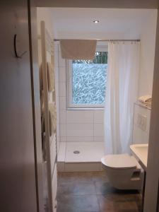 A bathroom at Travel Apartments