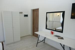 A television and/or entertainment centre at Apart-Hotel Domodedovo