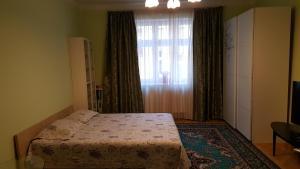 Postel nebo postele na pokoji v ubytování Byt v centru Karlových Varů