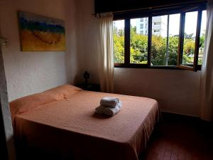 Una cama o camas en una habitación de Apart Hotel Sahara