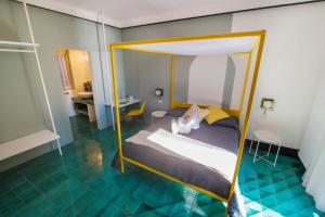 A bed or beds in a room at Ninina Boutique Suites