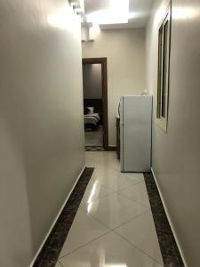 Um banheiro em Masa Homes Furnished Apartments