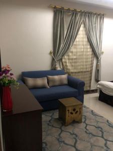 Uma área de estar em Masa Homes Furnished Apartments