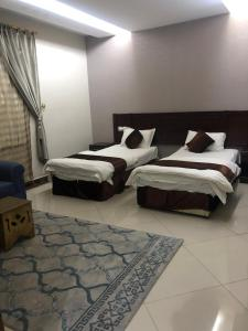 Cama ou camas em um quarto em Masa Homes Furnished Apartments