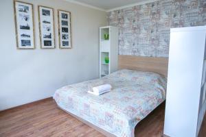 Кровать или кровати в номере Апартаменты на Трехгорном Валу