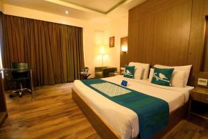 A bed or beds in a room at Jaipur CM-A Luxury Boutique Hotel