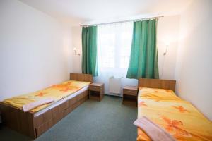 Posteľ alebo postele v izbe v ubytovaní Penzión Krahule