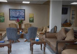 A seating area at Shweiki International Hotel