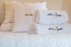 Cama o camas de una habitación en Oro y Luz