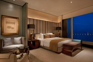 A bed or beds in a room at MGM Macau