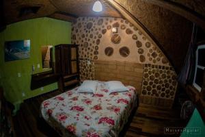Cama ou camas em um quarto em Verde Vida Ecopousada