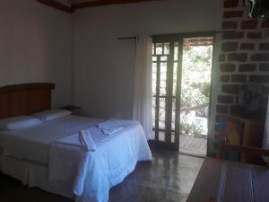Cama ou camas em um quarto em Pousada Bangalôs Cipó