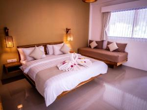 A bed or beds in a room at Mango Lodge