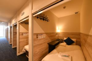 A bed or beds in a room at Blue Cabin Ishigaki Jima