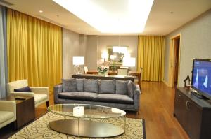 A seating area at Hotel Grand Swiss