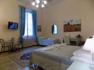 A bed or beds in a room at Soggiorno Pitti