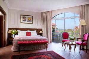 מיטה או מיטות בחדר ב-מלון פסטורל - כפר בלום