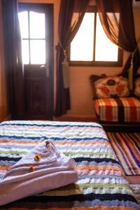 Ein Bett oder Betten in einem Zimmer der Unterkunft Riad Atlas Panorama