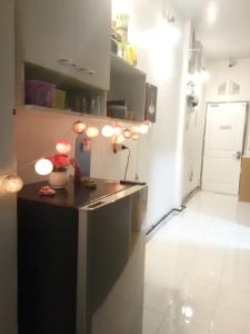 A kitchen or kitchenette at Home Room House
