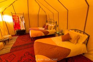 A bed or beds in a room at Luxury Bega Camp