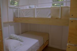 Litera o literas de una habitación en Jaguar Inn Bungalows & Hostel