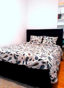 Łóżko lub łóżka w pokoju w obiekcie Apartament Piastowska