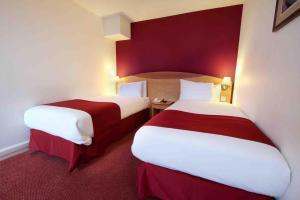 Cama o camas de una habitación en Waterloo Hub Hotel and Suites