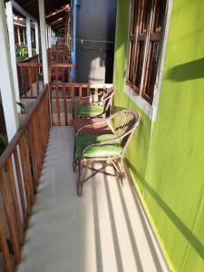 A balcony or terrace at Om Shanti Patnem