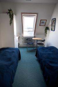 A bed or beds in a room at Danhostel Odense Kragsbjerggaard
