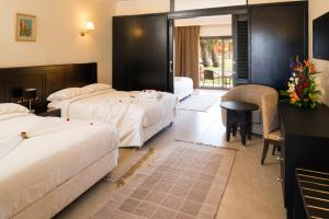 A bed or beds in a room at Aqua Fun Club All inclusive